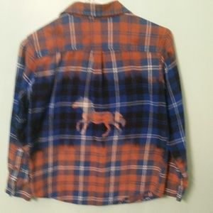 Distressed and stenciled flannel shirt